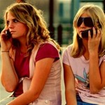 Two girls chatting on cell phones